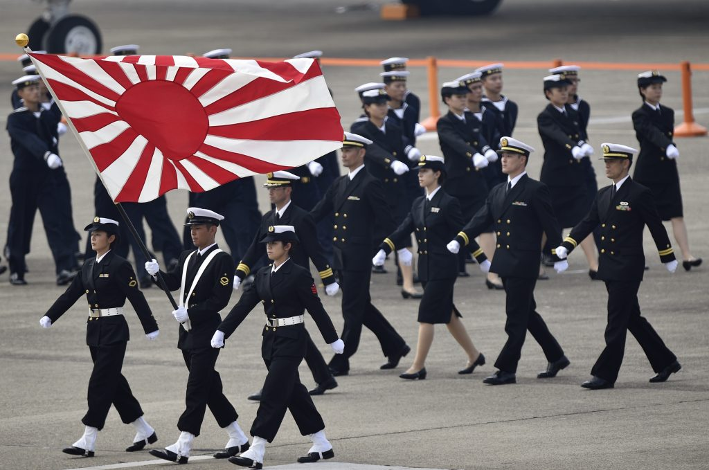epa05234271 (FILE) A file photo dated 26 October 2014 showing Japan's Self-Defense Force (JSDF) members marching during the JSDF Air Review at Hyakuri air base in Omitama, Ibaraki prefecture, Japan. The country's new defense laws come into effect on 29 March 2016 that will allow Japanese troops to fight overseas for the first time since World War II. The bill will allow Japanese troops to defend its allies and provide logistical support if attacked and participate in UN security operations and those aiming at maritime security or releasing kidnapped Japanese citizens abroad. The measure that was driven by the conservative Liberal Democratic Party of prime minister Shinzo Abe and the 'New Komeito' party has been approved in the lower house in September 2015 amid mass protests.  EPA/FRANCK ROBICHON