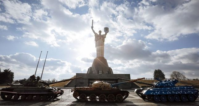 epa04647615 A tank T64B (L) said to have been seized from separatist rebels in the armed conflict in eastern Ukraine stands next to decorated tanks (C and R) which for many years form part of the musuem's exhibits, in front of Motherland monument at the Ukrainian State Museum of the Great Patriotic War of 1941-1945 Years in Kiev, Ukraine, 04 March 2015. Fresh accusations of duplicity on 03 March cast new doubts about the chances of a ceasefire taking hold in eastern Ukraine, with the government accusing separatists rebels taking up front-line positions after only a brief withdrawal. Both sides had agreed to pull heavy weapons back from the front after an agreement penned last month in Minsk. But there has been much doubt about whether the agreement was holding - doubts that will only loom larger after the charges on 03 March.  EPA/ROMAN PILIPEY