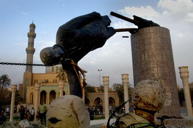 saddam-husseins-statue-pulled-down-by-us-marines