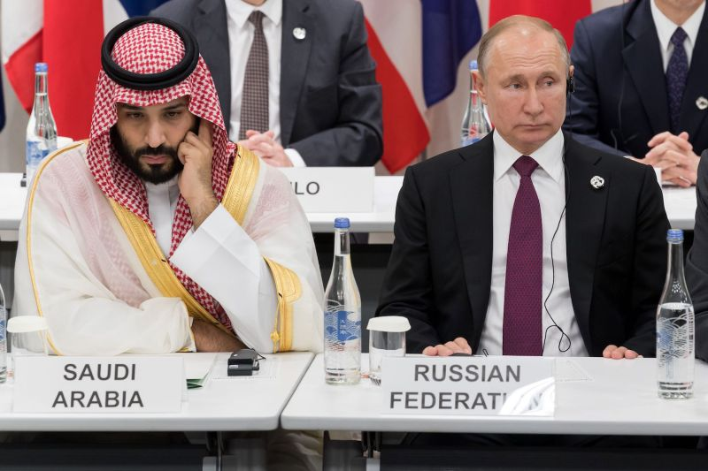 Saudi Arabia's Crown Prince Mohammed bin Salman (L) sits beside Russia's President Vladimir Putin as they attend a meeting on the digital economy at the G20 Summit in Osaka on June 28, 2019. (Photo by Jacques Witt / POOL / AFP)        (Photo credit should read JACQUES WITT/AFP via Getty Images)